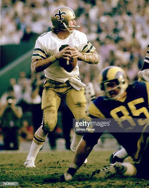 New Orleans Saints quarterback Archie Manning looks to pass in a 2413 loss to the Los Angeles Rams on November 25 1973 at Tulane Stadium in New...