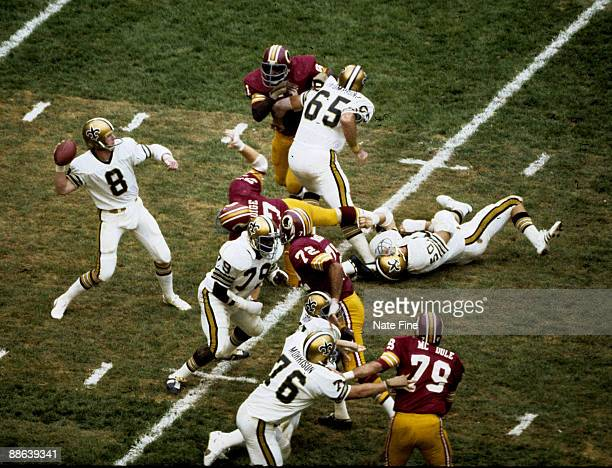 New Orleans Saints quarterback Archie Manning looks to pass in a 413 loss to the Washington Redskins on September 21 1975 at RFK Stadium in...