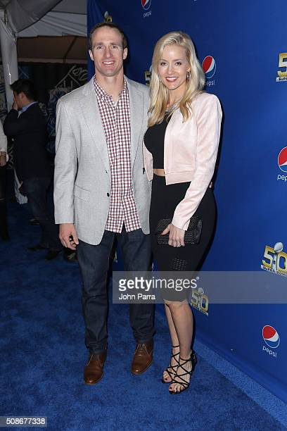 New Orleans Saints quarterback Drew Brees and Brittany Brees walk the Blue Carpet at the 2015 Pepsi Rookie of the Year Award Ceremony at Pepsi Super...