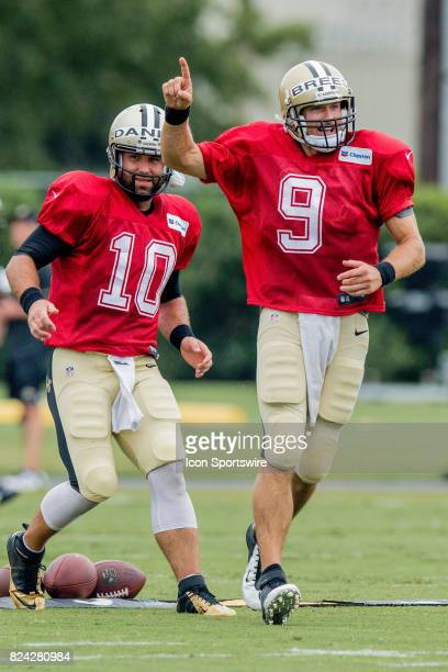 New Orleans Saints quarterback Drew Brees and quarterback Chase Daniel race to the next exercise during Training Camp on July 29 at the Ochsner...