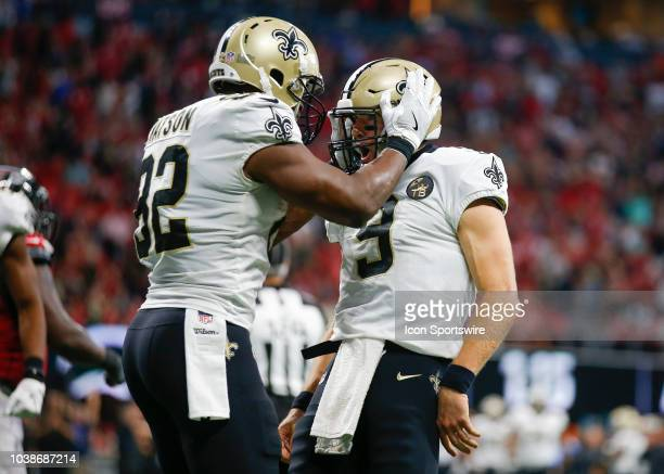 New Orleans Saints quarterback Drew Brees celebrates his touchdown with tight end Benjamin Watson in an NFL football game between the New Orleans...