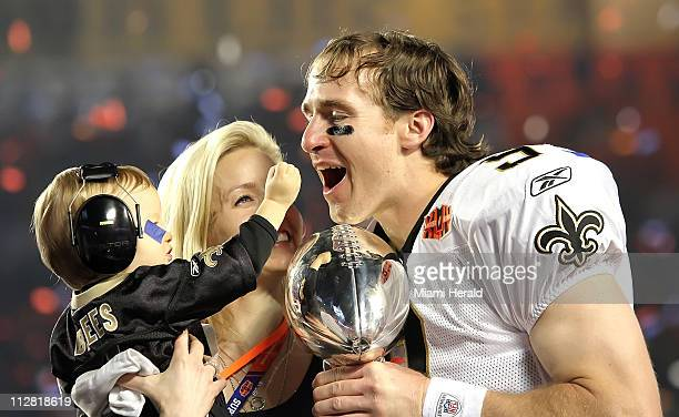 New Orleans Saints quarterback Drew Brees celebrates with his wife Brittany and son Baylen as Colts quarterback Peyton Manning leaves the field as...