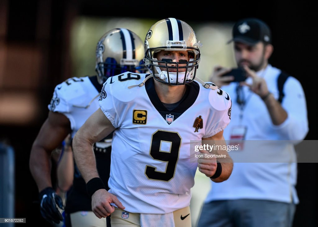 New Orleans Saints quarterback Drew Brees (9) enters the field prior to an NFL game between the New Orleans Saints and the Tampa Bay Buccaneers on December 31, 2017, at Raymond James Stadium in Tampa, FL.