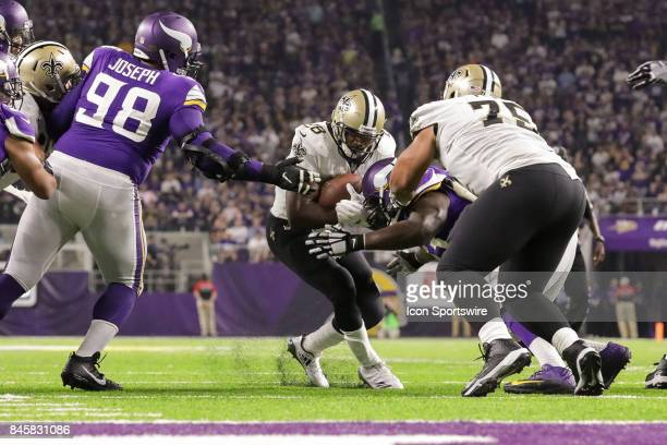 New Orleans Saints quarterback Drew Brees hands the ball off to running back Adrian Peterson during the game between between the Minnesota Vikings...