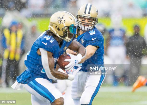 New Orleans Saints quarterback Drew Brees hands the ball off to New Orleans Saints running back Alvin Kamara During the NFL Pro Bowl match between...