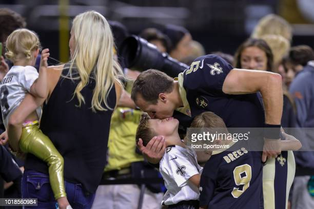New Orleans Saints quarterback Drew Brees kisses his boys in an NFL preseason football game between the New Orleans Saints and the Arizona Cardinals...