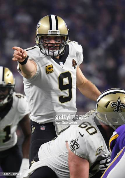 New Orleans Saints quarterback Drew Brees makes a call at the line of scrimmage during a NFC Divisional Playoff game between the Minnesota Vikings...