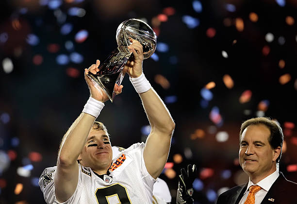 New Orleans Saints quarterback Drew Brees (9) raises the Vince Lombardi  Trophy after being efee2e8be