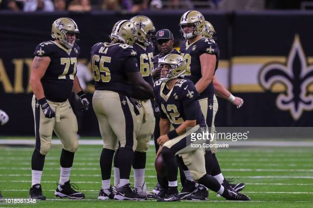 New Orleans Saints quarterback Tom Savage gets up after a sack in an NFL preseason football game between the New Orleans Saints and the Arizona...