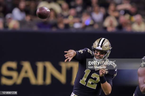 New Orleans Saints quarterback Tom Savage passes downfield in an NFL preseason football game between the New Orleans Saints and the Arizona Cardinals...