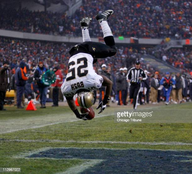 New Orleans Saints' Reggie Bush wows the crowd as he flips into the end zone for a third quarter touchdown against the Chicago Bears during the NFC...