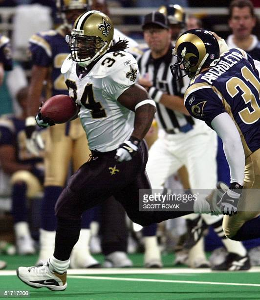 New Orleans Saints' Ricky Williams runs for a first touchdown in the third quarter as St Louis Rams' Adam Archuleta attempts to catch him in St Louis...