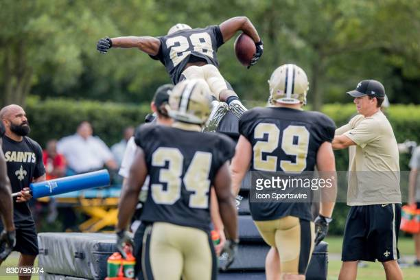 New Orleans Saints running back Adrian Peterson leaps over 8 pads on goal line drills during Training Camp on August 12 at the Ochsner Sports...