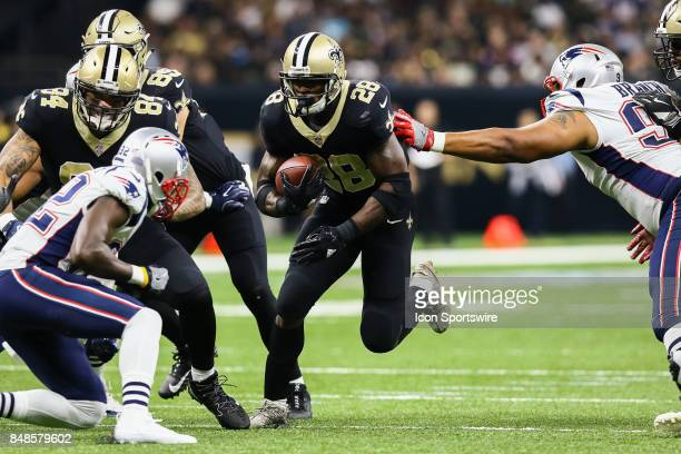 New Orleans Saints running back Adrian Peterson runs against New England Patriots during the game between between the New England Patriots and the...