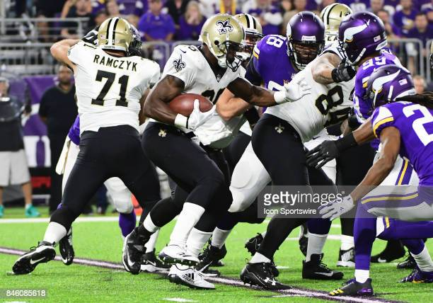 New Orleans Saints running back Adrian Peterson runs with the ball during a NFL game between the Minnesota Vikings and New Orleans Saints on...