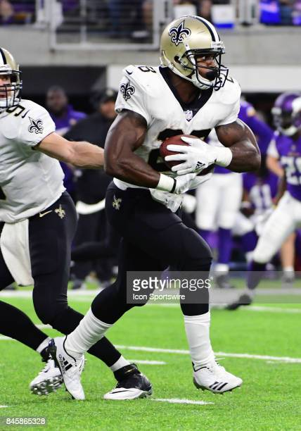 New Orleans Saints running back Adrian Peterson takes a hand off from New Orleans Saints quarterback Drew Brees during a NFL game between the...