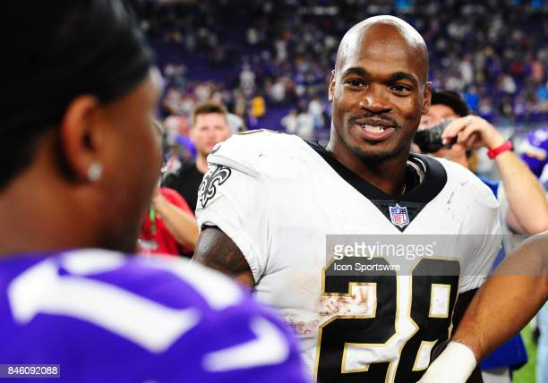 New Orleans Saints running back Adrian Peterson talks with Vikings players after a NFL game between the Minnesota Vikings and New Orleans Saints on...