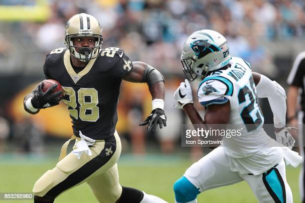 New Orleans Saints running back Adrian Peterson tries to outrun Carolina Panthers cornerback Daryl Worley during the first quarter of the game...