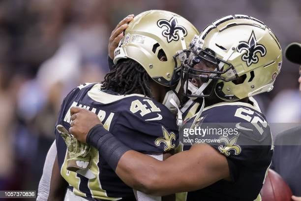 New Orleans Saints running back Alvin Kamara and New Orleans Saints running back Mark Ingram react to start the play against Los Angeles Rams on...