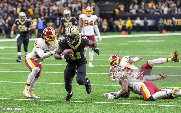 New Orleans Saints running back Alvin Kamara beats the Washington Redskins defense into the end zone for a touchdown during fourth quarter action He...