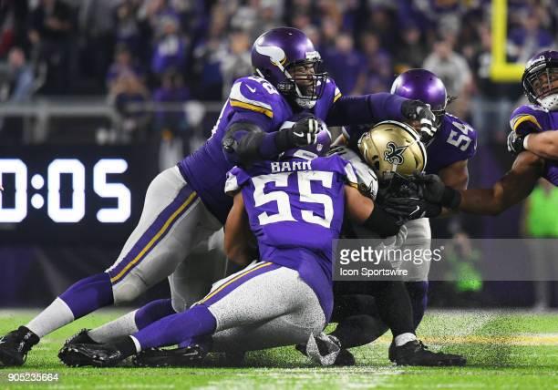 New Orleans Saints running back Alvin Kamara is smothered by Minnesota Vikings linebacker Eric Kendricks Minnesota Vikings defensive tackle Linval...