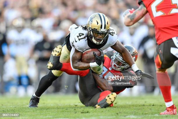 New Orleans Saints running back Alvin Kamara is tackled by Tampa Bay Buccaneers cornerback Javien Elliott during the first half of an NFL game...