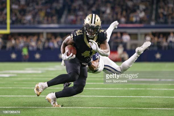 New Orleans Saints Running Back Alvin Kamara makes a move around Dallas Cowboys Cornerback Byron Jones during the game between the Dallas Cowboys and...