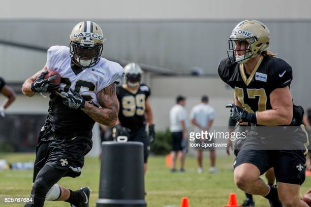 New Orleans Saints running back Daniel Lasco is chased by linebacker Alex Anzalone during Training Camp on August 02 at the Ochsner Sports...
