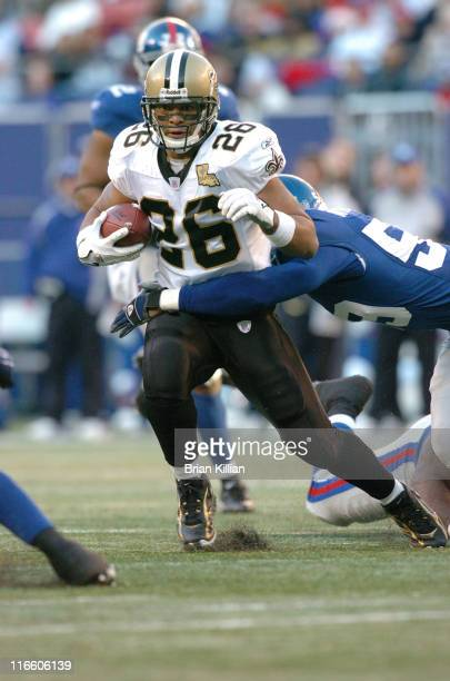 New Orleans Saints running back Deuce McAllister with a carry against the New York Giants at Giants Stadium in East Rutherford NJ on December 24th...