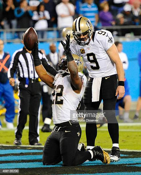 New Orleans Saints running back Mark Ingram celebrates his 3yard touchdown run against the Carolina Panthers along with quarterback Drew Brees during...