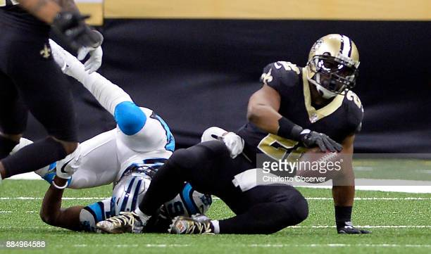 New Orleans Saints running back Mark Ingram gets up after being tackled by Carolina Panthers cornerback Daryl Worley after a long run during the...