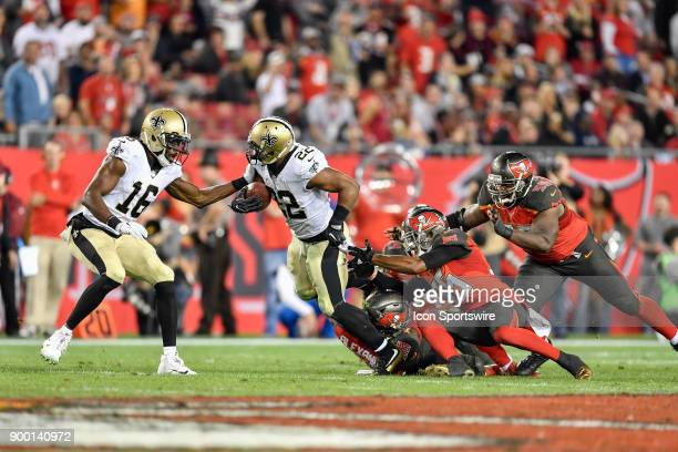 New Orleans Saints running back Mark Ingram II tries to break through the tackle by Tampa Bay Buccaneers linebacker Kwon Alexander and Tampa Bay...