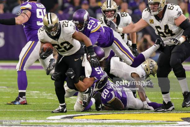 New Orleans Saints running back Mark Ingram is tackled by Minnesota Vikings middle linebacker Eric Kendricks and cornerback Terence Newman during the...