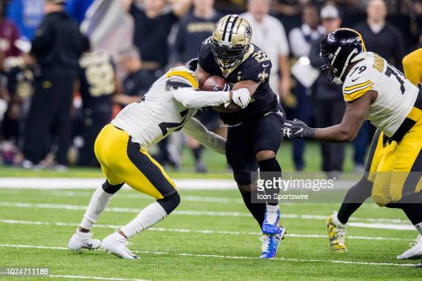 New Orleans Saints running back Mark Ingram is tackled by Pittsburgh Steelers nose tackle Javon Hargrave on December 23 2018 at the MercedesBenz...