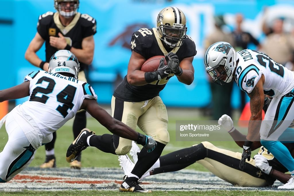 New Orleans Saints running back Mark Ingram (22) runs past Carolina Panthers cornerback James Bradberry (24) and free safety Kurt Coleman (20) during the second half of the game on September 24, 2017 between the New Orleans Saints and the Carolina Panthers at Bank of America Stadium in Charlotte, NC..