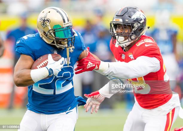 New Orleans Saints running back Mark Ingram runs the ball and a28 reaches for the tackle During the NFL Pro Bowl match between the AFC NFC on January...