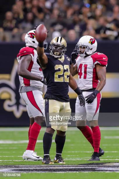 New Orleans Saints running back Mark Ingram scores a first down in an NFL preseason football game between the New Orleans Saints and the Arizona...