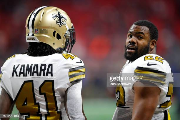 New Orleans Saints running back Mark Ingram speaks with running back Alvin Kamara prior to an NFL football game between the New Orleans Saints and...