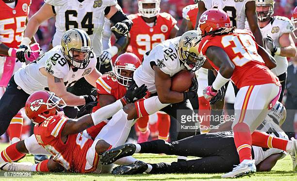 New Orleans Saints running back Mark Ingram starts to go down as Kansas City Chiefs' Terrance Mitchell rushes in to punch the ball loose for a fumble...