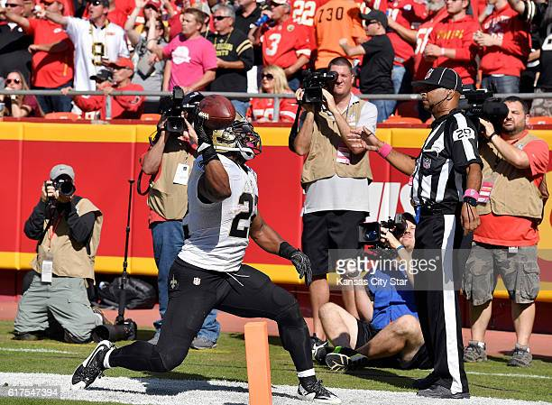New Orleans Saints running back Mark Ingram throws the football into the end zone pads after scoring in the third quarter against the Kansas City...