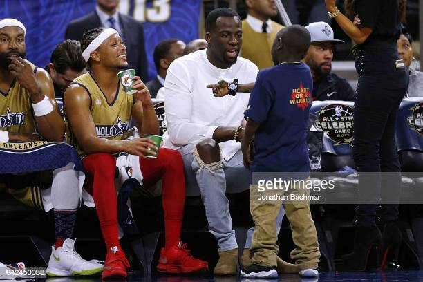 New Orleans Saints Super Fan Jarrius 'Little JJ' Robertson talks to Draymond Green of the Golden State Warriors during the NBA AllStar Celebrity Game...