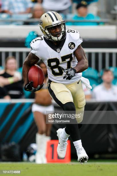 New Orleans Saints wide receiver Brandon Tate returns a kickoff during the game between the New Orleans Saints and the Jacksonville Jaguars on August...