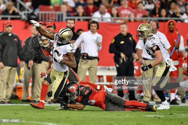 New Orleans Saints wide receiver Michael Thomas brought down by Tampa Bay Buccaneers cornerback Robert McClain during the second half of an NFL game...