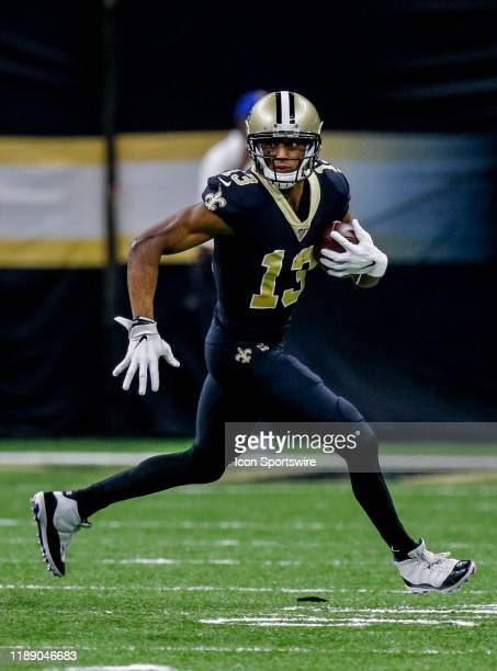 New Orleans Saints wide receiver Michael Thomas catches a pass against Indianapolis Colts safety Khari Willis on December 16 2019 at the MercedesBenz...