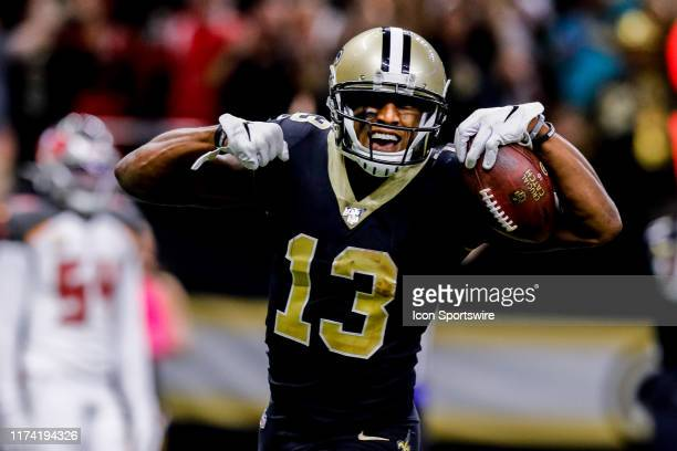 New Orleans Saints wide receiver Michael Thomas runs in for a touchdown and celebrates during the game between the New Orleans Saints and the Tampa...
