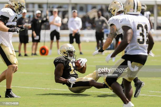 New Orleans Saints wide receiver Michael Thomas scores a touchdown pass from quarterback Drew Brees during training camp on August 2 2019 at the...