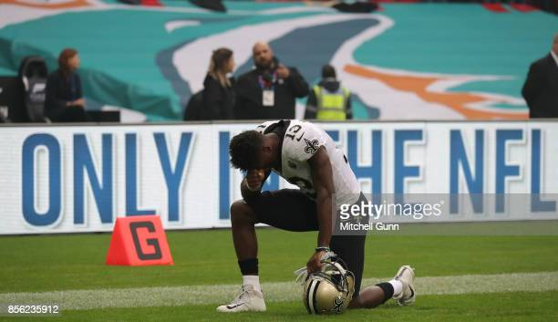 New Orleans Saints wide receiver Michael Thomas takes a knee before the NFL match between the Miami Dolphins and the New Orleans Saints at Wembley...