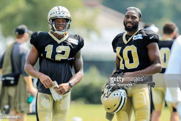 New Orleans Saints wide receiver Rishard Matthews and wide receiver Tre'Quan Smith share a moment during training camp on August 2 2019 at the...