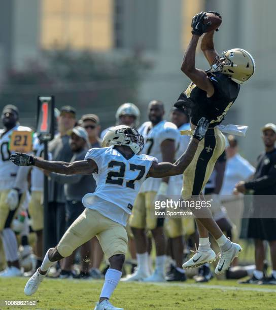 New Orleans Saints wide receiver Tre'Quan Smith and defensive back Natrell Jamerson run through a drill during New Orleans Saints training camp...