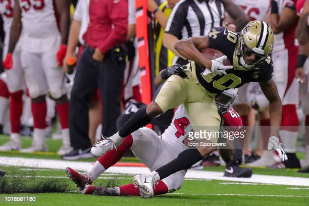 New Orleans Saints wide receiver Tre'Quan Smith is tackled by Arizona Cardinals defensive back AJ Howard in an NFL preseason football game between...